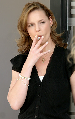 Marg Helgenberger smoking a cigarette (or weed)